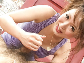 Japanese babe Sayaka Tsuzi teases two guys upside down on a couch before jerking them off